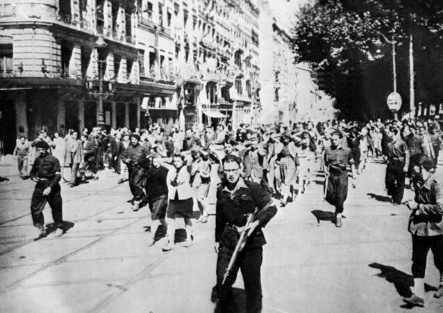 Nazi collaborators, guarded by members of the French resistance, being marched through Lyon at the end of the Second World War