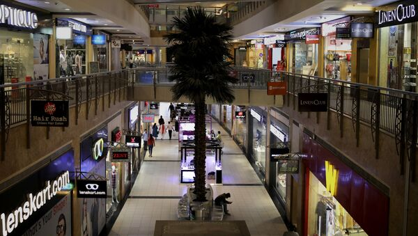 Few shoppers are seen inside a shopping mall amid a new virus outbreak in New Delhi, India, Tuesday, March 17, 2020 - Sputnik International