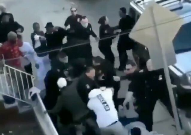 Massive brawl involving 100 individuals, including multiple police officer, prompts internal investigation by the Jersey City Police Department.