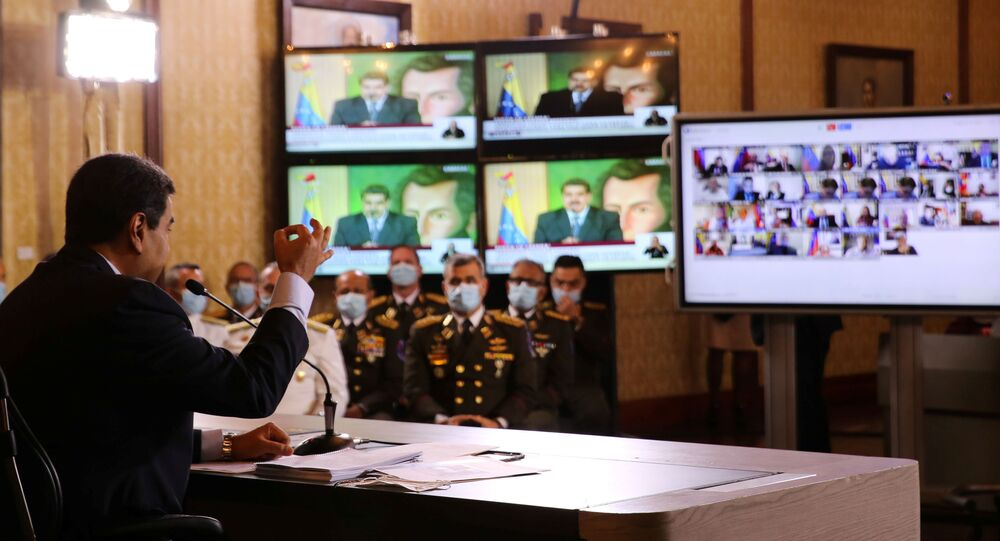 Screens are seen as Venezuela's President Nicolas Maduro holds a virtual news conference in Caracas, Venezuela May 6, 2020.