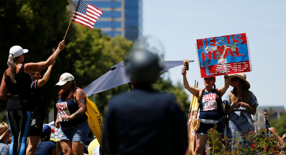 Demonstrators rally in front of the California State Capital building during a protest calling for the reopening of California, amid the outbreak of the coronavirus disease (COVID-19), in Sacramento, California, U.S. May 7, 2020.