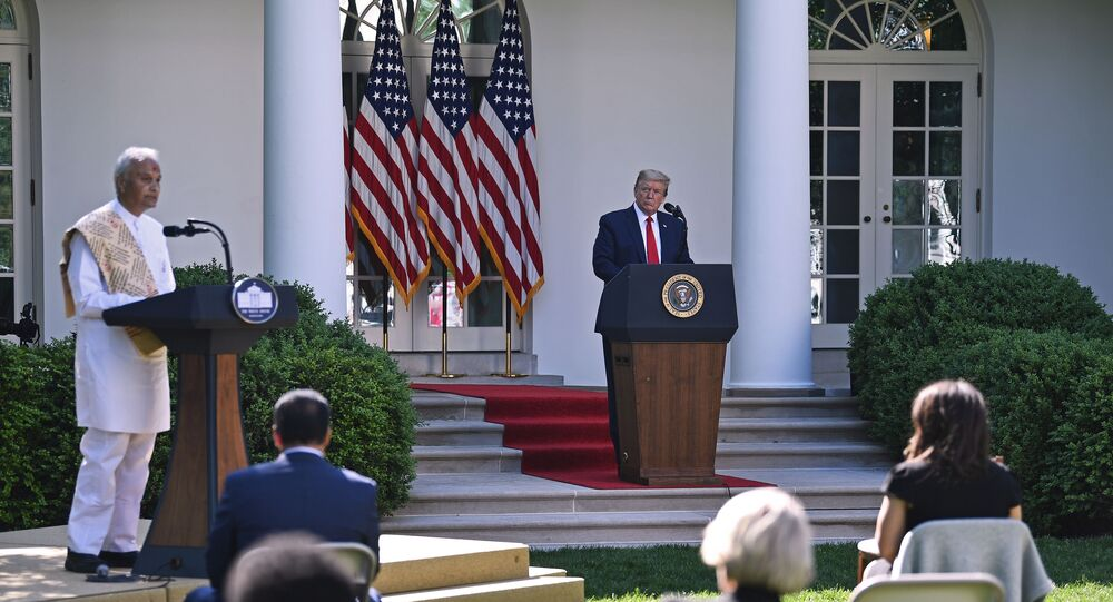 Pujari Harish Brahmbhatt, B.A.P.S. Shri Swaminarayan Mandir, Robbinsville, speaks as US President Donald Trump looks on during the National Day of Prayer Service event at the Rose Garden of the White House in Washington, DC on May 7, 2020.