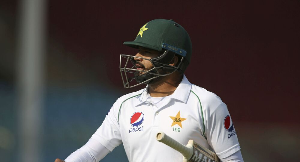 Pakistani captain Azhar Ali walks on his way to pavilion after being bowled by Sri Lankan Vishwa Fernando during the second Test in Karachi, Pakistan, Thursday, Dec. 19, 2019
