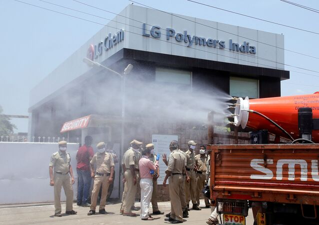 Municipal workers decontaminate the area outside of the LG Polymers Plant following a gas leak at the plant in Visakhapatnam, India, May 8, 2020.