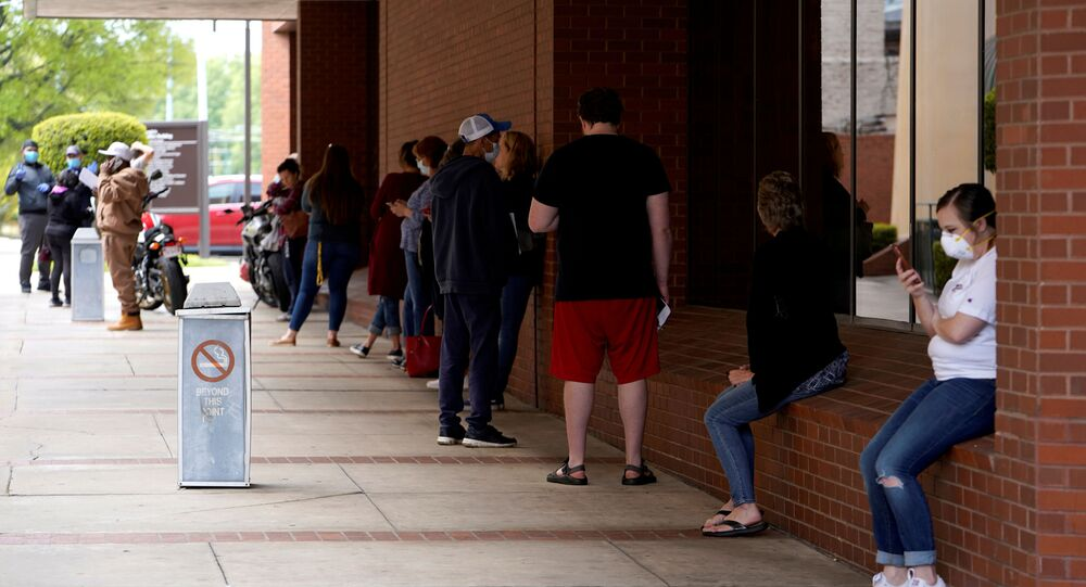 People who lost their jobs wait in line to file for unemployment following an outbreak of the coronavirus disease (COVID-19), at an Arkansas Workforce Center in Fort Smith, Arkansas, U.S. April 6, 2020