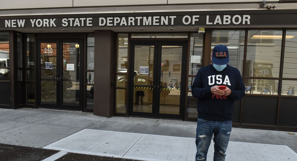 Luis Mora stands in front of the closed offices of the New York State Department of Labor on May 7, 2020 in the Brooklyn borough in New York City