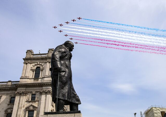 In a handout picture released by the British Ministry of Defence (MOD) on May 8, 2020, the Royal Air Force Red Arrows fly over the statue of Sir Winston Churchill to mark the 75th anniversary of VE Day (Victory in Europe Day), the end of the Second World War in Europe, in central London
