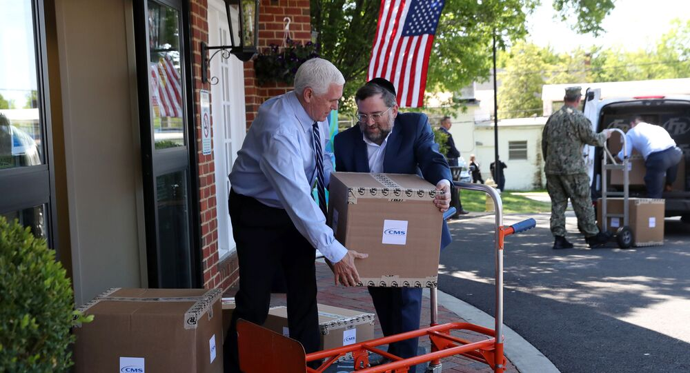 U.S. Vice President Mike Pence unloads boxes of personal protective equipment (PPE) with Norman Rokeach, CEO of Marquis Health Services, while helping to deliver a shipment that was provided by the Federal Emergency Management Administration (FEMA) to the Woodbine Rehabilitation and Healthcare Center in Alexandria, Virginia., U.S., May 7, 2020