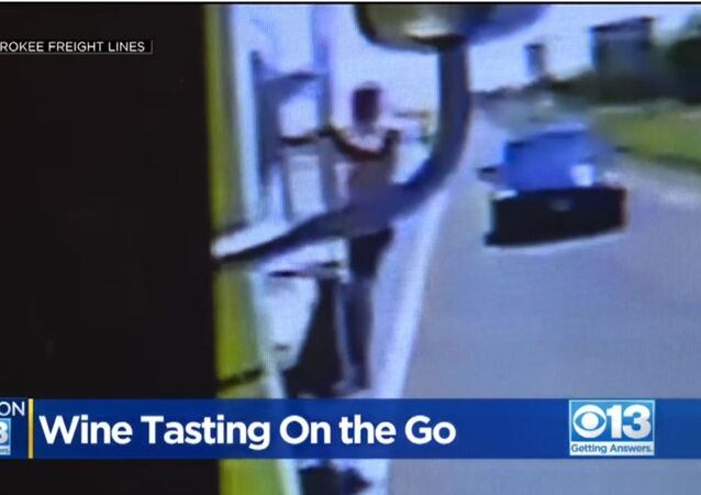 Grape Theft Auto: Dashcam Captures California Man Chugging Wine From Moving Big Rig