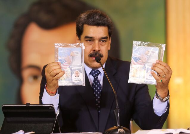Personal documents are shown by Venezuela's President Nicolas Maduro during a virtual news conference in Caracas, Venezuela May 6, 2020.