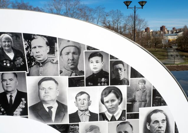 A fragment of a ten-meter installation with photographs of participants in the Great Patriotic War installed in the eternal flame at the memorial complex Eternal Flame of Glory and the Tomb of the Unknown Soldier in Petrozavodsk.