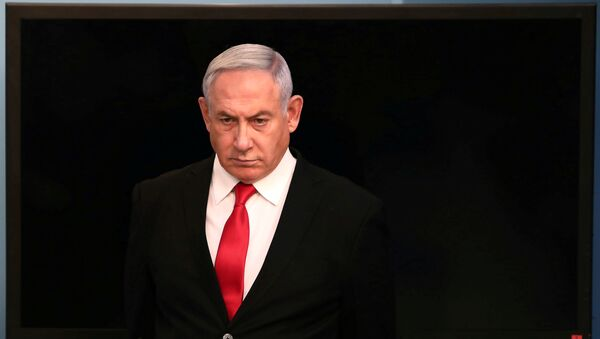 Israeli Prime Minister Benjamin Netanyahu arrives for a speech at his Jerusalem office, regarding the new measures that will be taken to fight the coronavirus, March 14, 2020 - Sputnik International