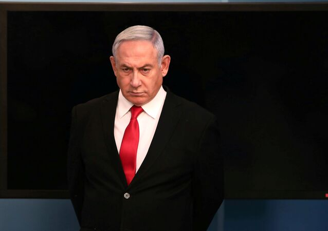 Israeli Prime Minister Benjamin Netanyahu arrives for a speech at his Jerusalem office, regarding the new measures that will be taken to fight the coronavirus, March 14, 2020
