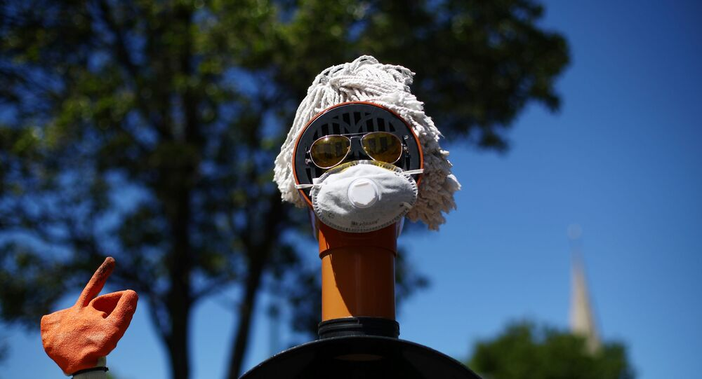 A sculpture surrounding a bollard consisting of plumbing materials, sunglasses and a protective face mask is seen in Lewisham following the outbreaK of coronavirus disease (COVID-19), London, Britain, May 5, 2020