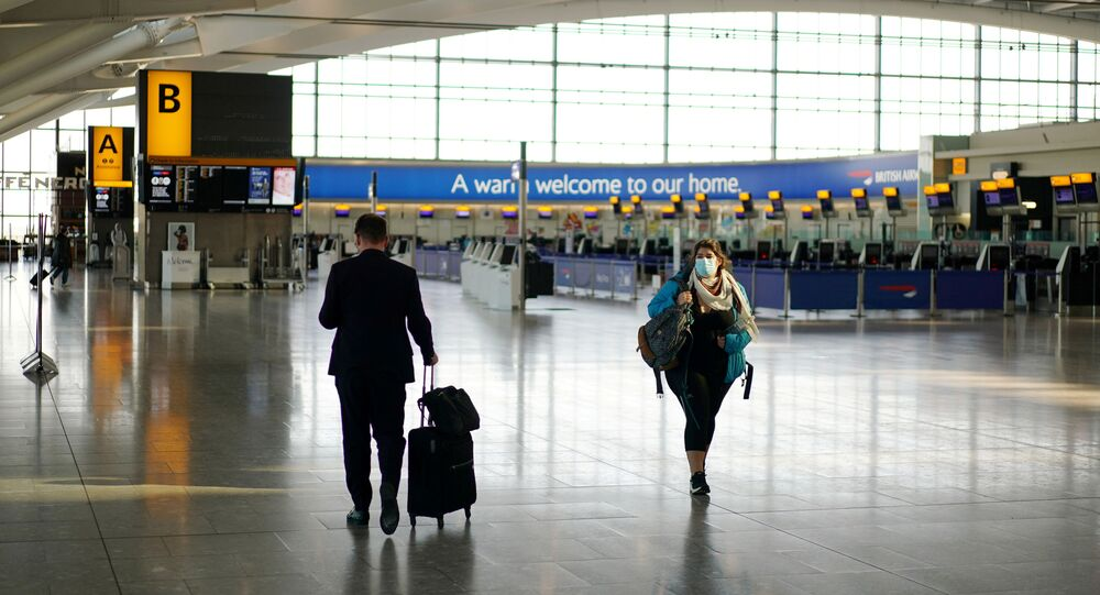 A woman wearing a mask is seen at Heathrow airport, London, Britain, April 5, 2020.