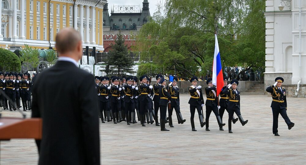 Russian President Vladimir Putin attends a parade of the Kremlin Regiment - also known as the Presidential Regiment - as part of the Victory Day events commemorating its 75th anniversary