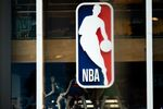 In this file photo taken on March 11, 2020 an NBA logo is shown at the 5th Avenue NBA store in New York City.   BasketNBAhealthvirustests - The NBA has advised teams not to arrange coronavirus tests for players and staff not showing symptoms, ESPN reported on May 1, 2020, saying it was inappropriate with only limited public testing available.