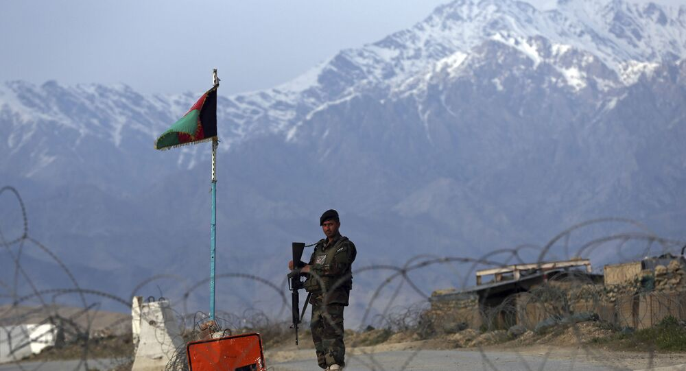An Afghan National Army soldier stands guard at a checkpoint near the Bagram base north of Kabul, Afghanistan, Wednesday, April 8, 2020. An Afghan official said Wednesday that the country has released 100 Taliban prisoners from Bagram, claiming they are part of 5,000 detainees who are to be freed under a deal between insurgents and U.S. But the Taliban says they have yet to verify those released were on the list they had handed over to Washington during negotiations.