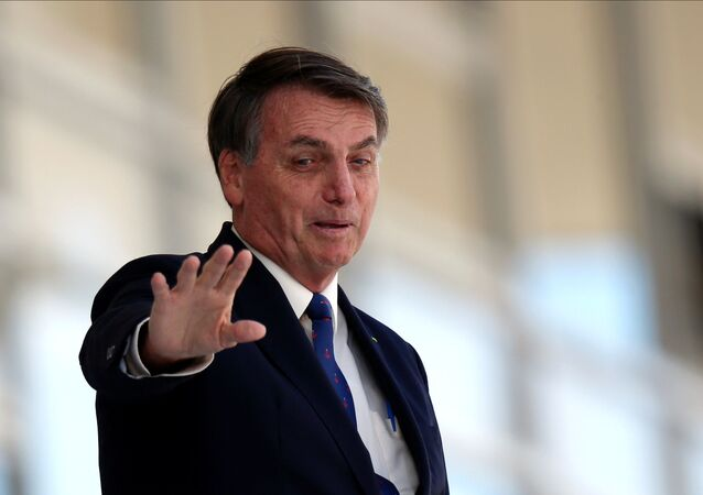 Brazil's President Jair Bolsonaro gestures as he stands at the ramp of the Planalto Palace, amid the coronavirus disease (COVID-19) outbreak in Brasilia, Brazil April 27, 2020