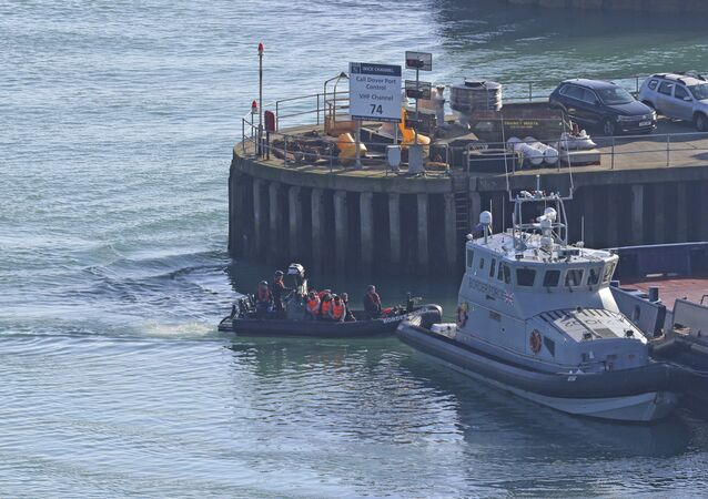 A Border Force boat returns to Dover, Kent, England