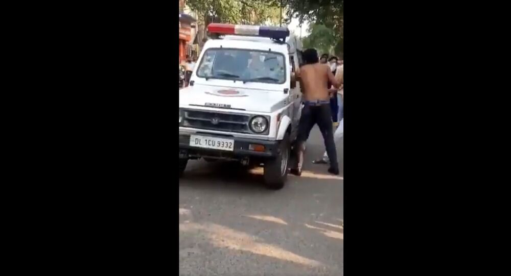 A drunk man allegedly broke the windshield of a police vehicle with his fist and engaged in an altercation with officials in East Delhi's Kalyanpuri, law enforcement said on Saturday.