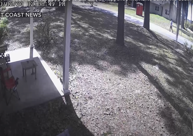 Screenshot of the video of Ahmaud Arbery walking around a home construction site