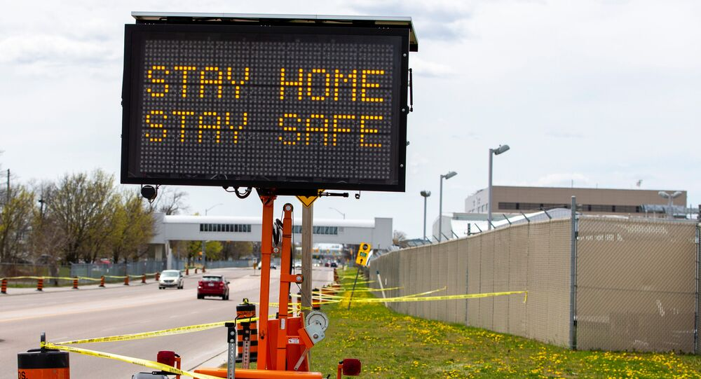 Concerns for physical distancing and the spread of the coronavirus disease (COVID-19) made the military base put up a sign and caution tape which stopped people from congregating to watch the repatriation ceremony for the six Canadian Forces personnel killed in a helicopter crash in the Mediterranean, at Canadian Forces Base in Trenton, Ontario, Canada, May 6, 2020.