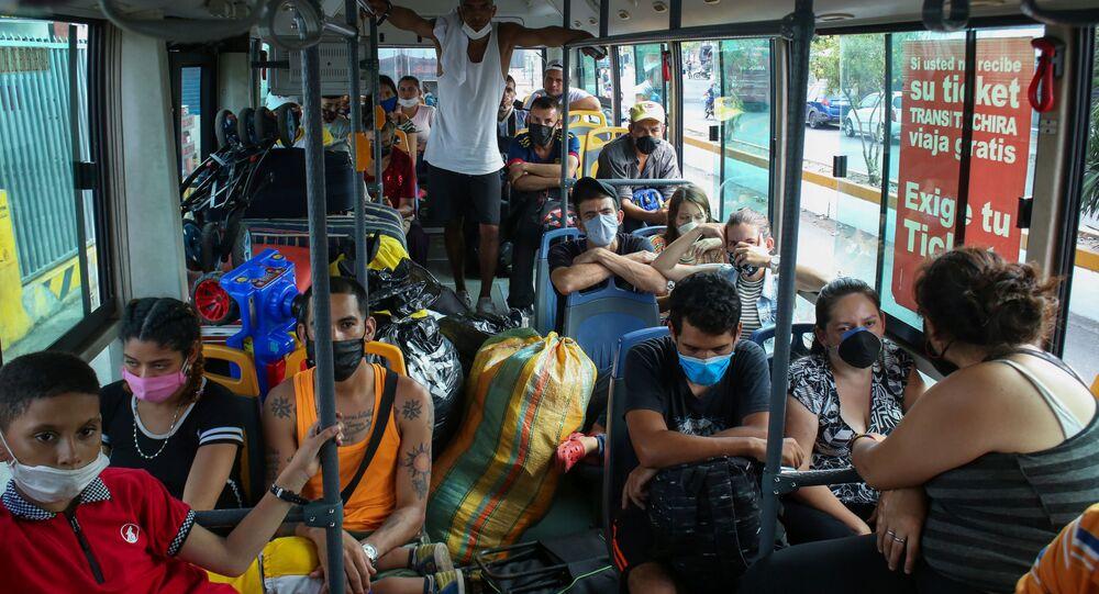 Venezuelan citizens return to homeland board by bus after spending 14 days in quarantine at Venezuela- Colombia border as the spread of the coronavirus disease (COVID-19) continues in San Antonio, Venezuela April 30, 2020. Picture taken April 30, 2020