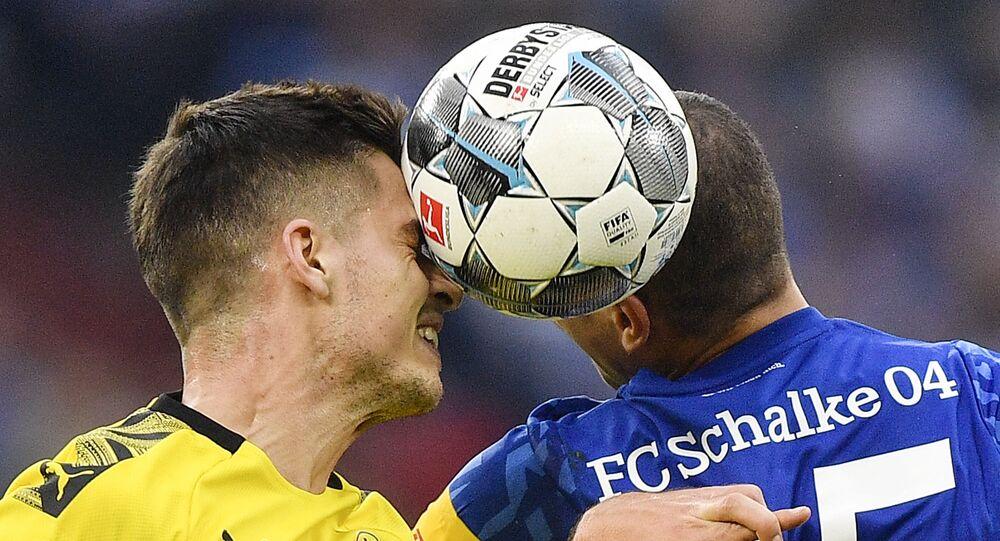 Dortmund's Julian Weigl and Schalke's Amine Harit challenge for the ball during the Bundesliga derby match in October 2019.