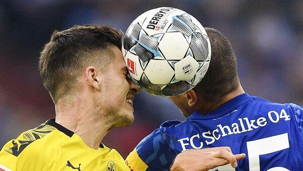 Action from the 2019 derby match between Borussia Dortmund and Schalke 04 - Sputnik International