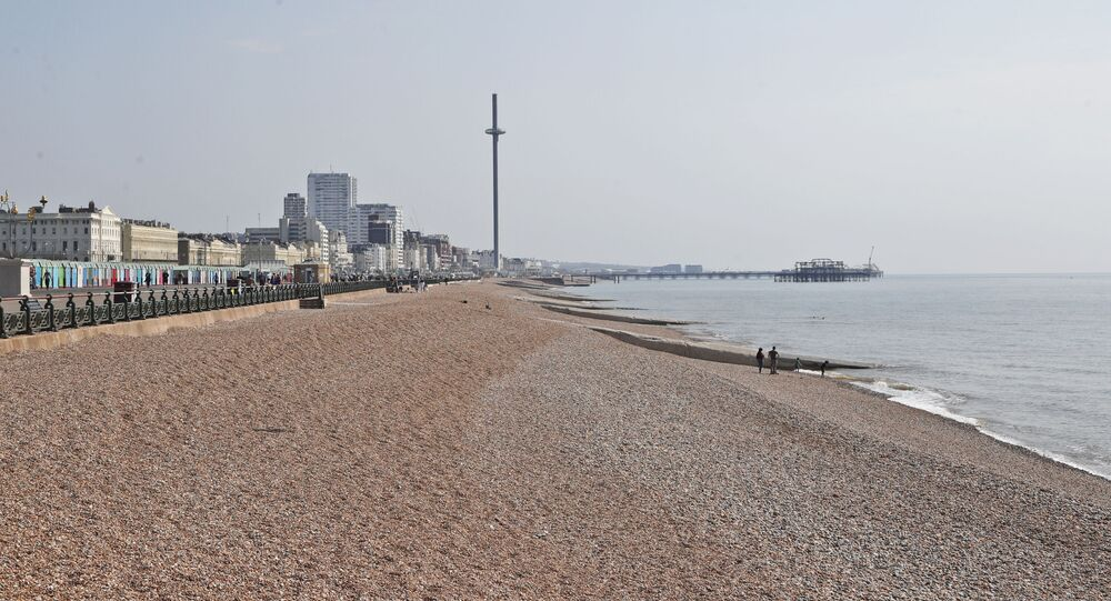 The beaches are nearly empty on a warm and sunny day after the coronavirus outbreak and lockdown in Brighton, England, Saturday, April 11, 2020.