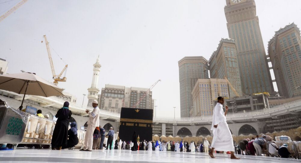 A small number of pilgrims circumambulate around the Kaaba, the cubic building at the Grand Mosque, during the minor pilgrimage, known as Umrah, in the Muslim holy city of Mecca, Saudi Arabia, Monday, March 2, 2020