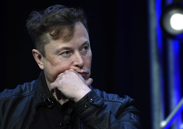 Tesla and SpaceX Chief Executive Officer Elon Musk listens to a question as he speaks at the SATELLITE Conference and Exhibition in Washington, Monday, March 9, 2020