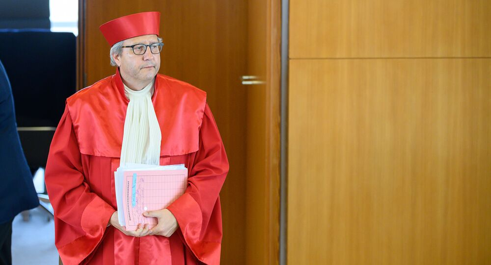 The chairman of the German constitutional court AndreasVosskuhle arrives on May 5, 2020 at the Constitutional court in Karlsruhe, to give out the court's ruling that the European Central Bank must clarify a key bond-buying scheme to support the eurozone economy is proportionate or else Germany's Bundesbank central bank may no longer participate.