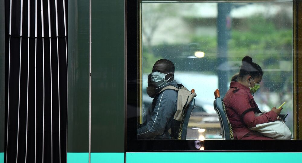 Commuters wear facemasks as they sit in a tram carriage in Paris on May 11, 2020, on the first day of France's easing of lockdown measures in place for 55 days to curb the spread of the COVID-19 pandemic, caused by the novel coronavirus.
