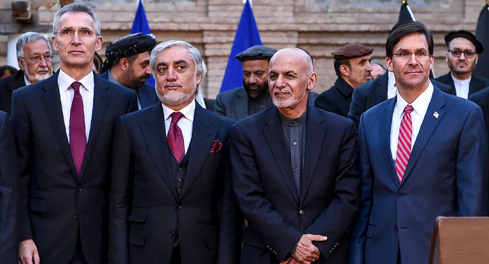 NATO Secretary General Jens Stoltenberg (L) pose along with Afghan presidential election opposition candidate Abdullah Abdullah (2L), Afghanistan's President Ashraf Ghani (2R) and US Secretary of Defense Mark Esper (R) after a press conference at the presidential palace in Kabul on February 29, 2020.