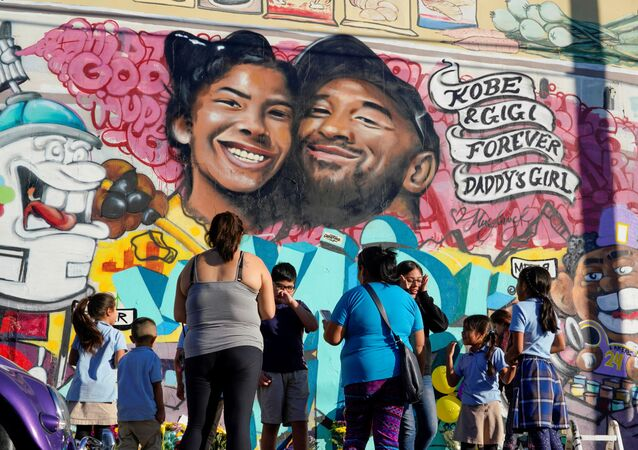 Fans gather around a mural to pay respects to Kobe Bryant after a helicopter crash killed the retired basketball star, in Los Angeles, California, U.S., January 28, 2020