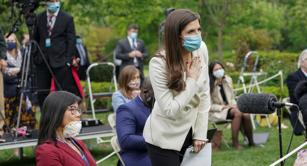 CNN White House correspondent Kaitlan Collins tries to ask her question of U.S. President Donald Trump after he called on her on the heels of an exchange with CBS News correspondent Weijia Jiang (L) during a coronavirus disease (COVID-19) outbreak response briefing at the White House in Washington, U.S., May 11, 2020. The president refused to hear Collins' question, then ended and left the news conference