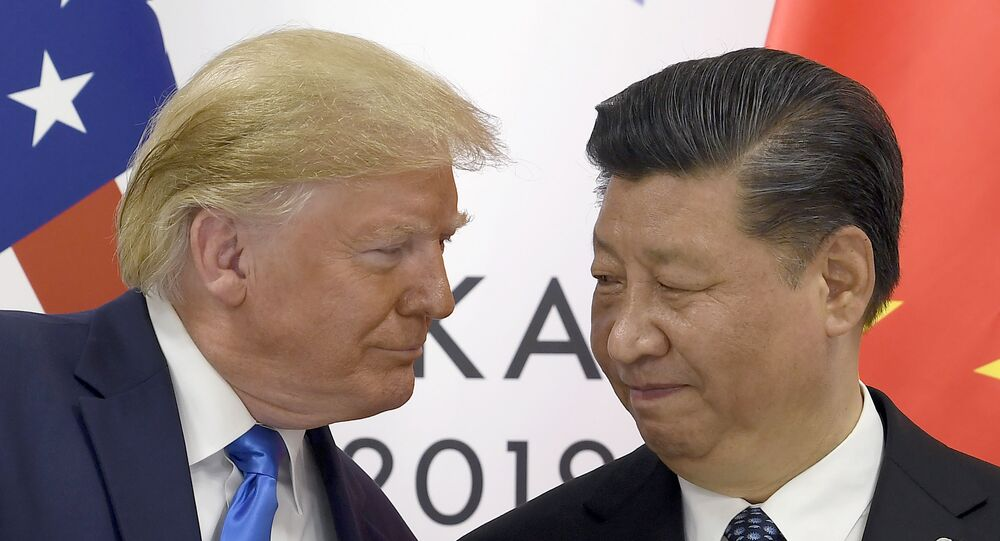 In this June 29, 2019, file photo, President Donald Trump, left, meets with Chinese President Xi Jinping during a meeting on the sidelines of the G-20 summit in Osaka, Japan.