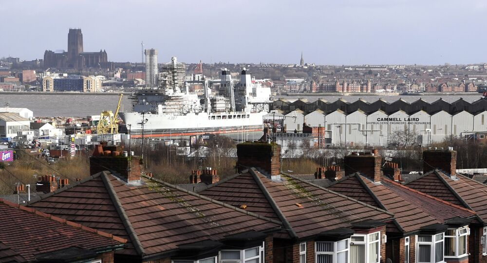 RFA Fort Victoria, a fort-class combined fleet stores ship and tanker of the UK's Royal Fleet Auxiliary, is resupplied at the Cammell Laird shipbuilders docks in Liverpool on January 16, 2018