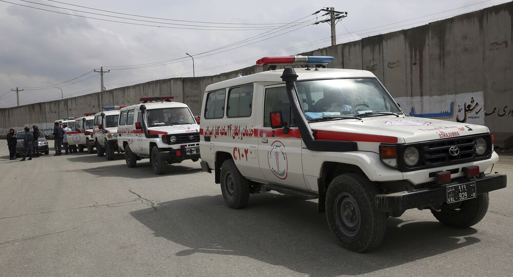 Ambulances wait near the site of an attack in Kabul, Afghanistan, Wednesday, March 25, 2020