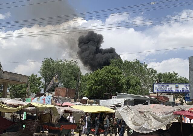 Smokes rises from a hospital after a gunmen attacked in Kabul, Afghanistan, Tuesday, May 12, 2020