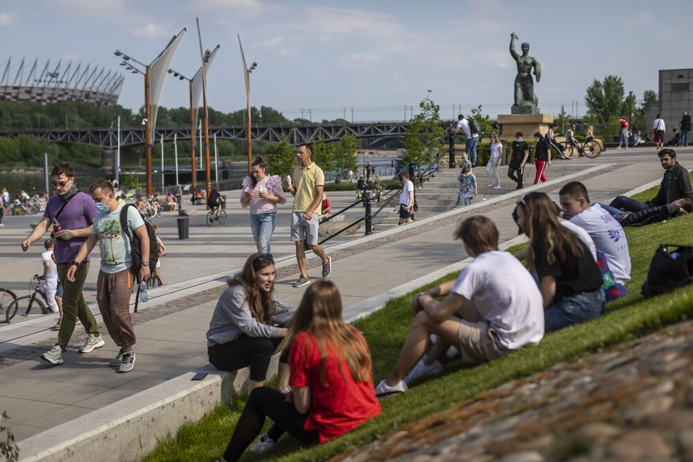 Warsaw residents crowdly gather on the bank of the Vistula River to enjoy the warm weather, despite the still uncontrolled pandemic of the new coronavirus COVID-19 and the restrictions and recommendations of social distancing, in Warsaw on May 10, 2020.