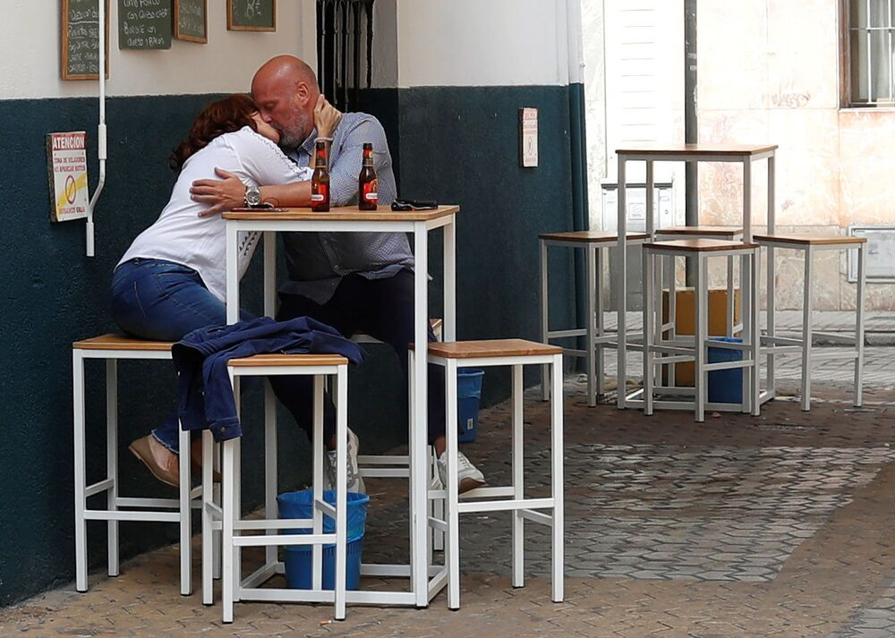 People sitting outside the bar Er Var kiss, as some Spanish provinces are allowed to ease restrictions during the phase one amid the coronavirus disease (COVID-19) outbreak, in Seville, Spain, 11 May 2020.