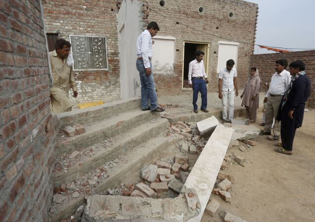 Pakistani Christians visit the site of a vandalized church in a village near Lahore, Pakistan, Monday, May 11, 2020