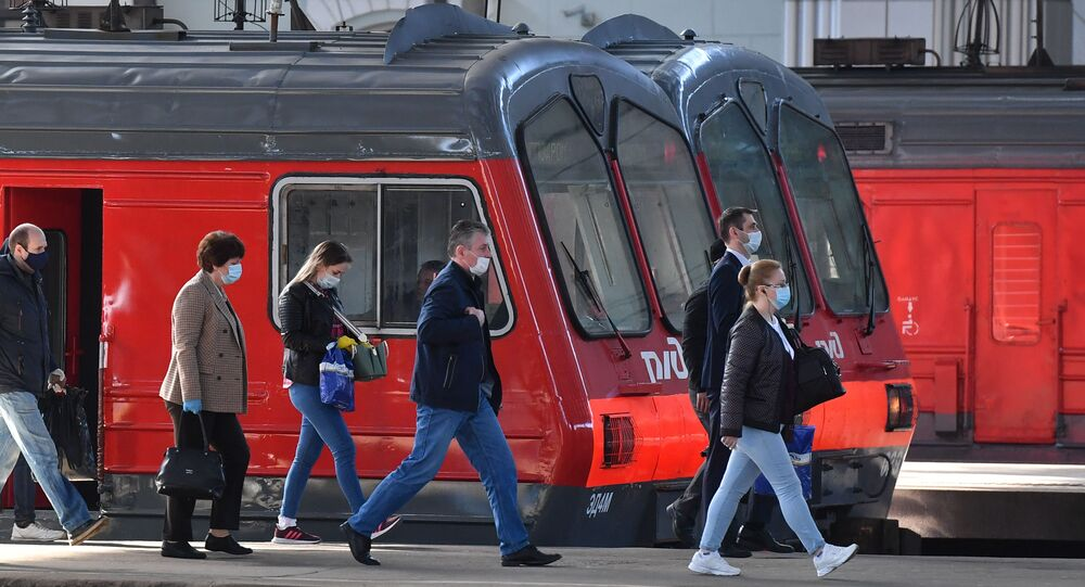 Passengers walk on a platform of Kazansky railway station amid the coronavirus outbreak, in Moscow, Russia. Russian authorities have started gradually easing coronavirus-related lockdown measures from May 12.