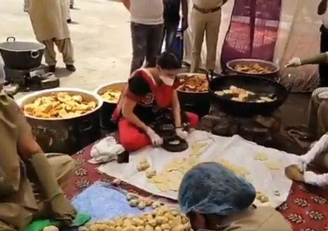 Sapna Choudhary, known for setting the stage on fire, roll 'Pooris' for the needy at Najafgarh Police station. She appreciated the female personnel for their service