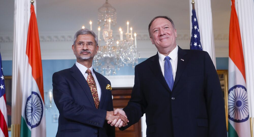 Secretary of State Mike Pompeo, right, shakes hands with Indian counterpart Subrahmanyam Jaishankar, left, at the US State Department in Washington, Monday, Sept. 30, 2019