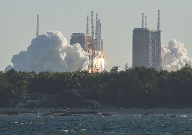 A Long March 5B rocket lifts off from the Wenchang launch site on China's southern Hainan island on May 5, 2020. - Chinese state media reported the successful launch of a new rocket on May 5, a major test of its ambitions to operate a permanent space station and send astronauts to the Moon.