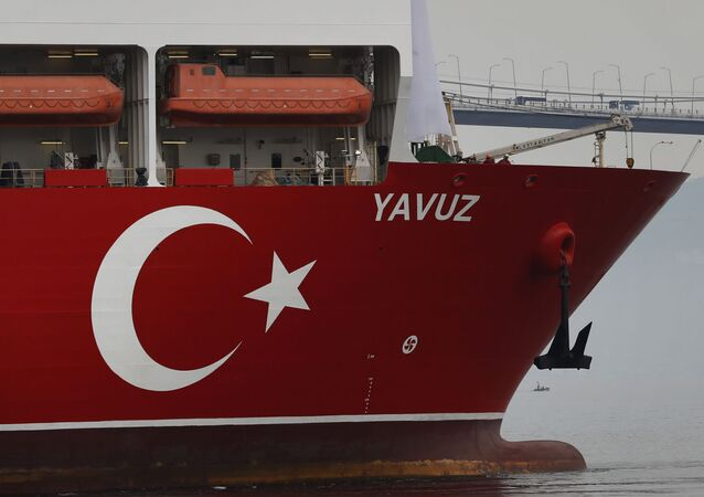 In this Thursday, June 20, 2019 file photo, Turkey's 230-meter (750-foot) drillship 'Yavuz' escorted by a Turkish Navy vessel, crosses the Marmara Sea on its way to the Mediterranean, from the port of Dilovasi, outside Istanbul